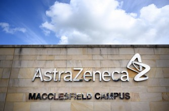 A logo is pictured on a wall outside the offices of pharmaceutical company AstraZeneca in Macclesfield, central England on May 11, 2021. - British pharmaceuticals giant AstraZeneca said Friday that its Covid vaccine generated $275 million (227 million euros) in sales in the first quarter, as its chief executive defended the company's performance in the face of EU legal action. (Photo by Paul ELLIS / AFP)