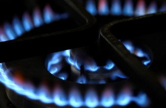 (FILES) This file photo taken on February 3, 2020 shows the flame of a gas stove in Dortmund, Germany. - European and UK gas prices surged on October 6, 2021 by more than 25 percent, energised by soaring demand before the northern hemisphere winter. (Photo by INA FASSBENDER / AFP)