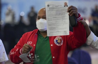 Senator Ronald dela Rosa files his certificate of candidacy for next year's presidential elections with the Commission on Elections in Manila on October 8, 2021. (Photo by Aaron Favila / POOL / AFP)
