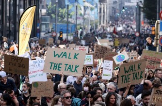 Protesters take part in a demonstration against climate change in Brussels, on October 10, 2021, ahead of the COP26 climate summit. - The COP26 climate summit is held from October 31 to November 12, 2021. (Photo by Kenzo TRIBOUILLARD / AFP)