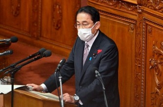 Japan's Prime Minister Fumio Kishida speaks during a question and answer session at the lower house of parliament in Tokyo on October 11, 2021. (Photo by Philip FONG / AFP)