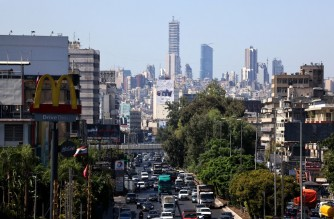 A picture shows the traffic in the area of Dora at the northern entrance of Lebanon's capital Beirut on October 7, 2021. - By challenging Lebanon's national passion for automobile ownership, and driving growing numbers towards greener or more collective transport, the economic crisis is succeeding where everything else failed. (Photo by Joseph EID / AFP)