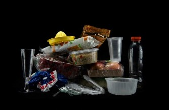 (FILES) In this file photo taken on August 12, 2018 this illustration shows plastic containers, cutlery and plastic wrapped food packaging taken in a studio in Paris. - Daily exposure to phthalates, a group of chemicals used in everything from plastic containers to makeup, may lead to approximately 100,000 deaths in older Americans annually, a study from New York University warned October 12, 2021. (Photo by Olivier MORIN / AFP)