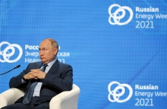 Russian President Vladimir Putin attends a session of the Russian Energy Week International Forum in Moscow on October 13, 2021. (Photo by SERGEI ILNITSKY / POOL / AFP)