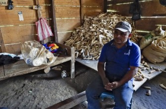 Lazaro Yat is seen at his house in Cerro Azul, Uspantan municipality, Quiche department, Guatemala, on September 28, 2021. - Disgrace got to Cerro Azul when hurricanes Eta and Iota hit Central America almost simultaneously between late October and the beginning of November in 2020. (Photo by Johan ORDONEZ / AFP)