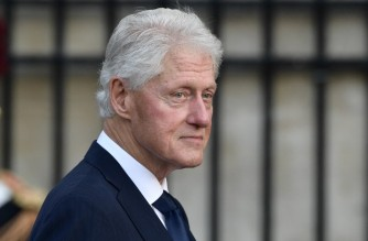 (FILES) In this file photo taken on September 30, 2019 former US President Bill Clinton arrives to attend a church service for former French President Jacques Chirac at the Saint-Sulpice church in Paris. - Former US President Bill Clinton has been admitted to UCI Medical Center for treatment of an infection not related to Covid-19, according to a statement released by his spokesperson Angel Urena on Twitter on October 14, 2021. (Photo by Martin BUREAU / AFP)