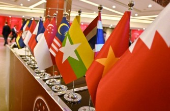 (FILES) In this file photo taken on November 4, 2019, the Myanmar national flag (C) is seen with flags of member countries attending the 35th Association of Southeast Asian Nations (ASEAN) Summit in Bangkok. - Myanmar's junta chief will be excluded from an upcoming ASEAN summit, the group said on October 16, 2021, a rare rebuke as concerns rise over the military government's commitment to defusing a bloody crisis. (Photo by Romeo GACAD / AFP)