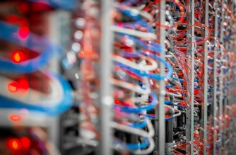 """This handout picture courtesy of OVHcloud shows servers inside a data center owned by French web provider OVHcloud, taken on April 7, 2016, in Beauharnois, near Montreal, Quebec. - With vast amounts of cheap and renewable electricity mostly generated from hydro dams, Quebec is seeing more and more tech giants setting up power-hungry data centres in the Canadian province. With demand for cloud services soaring, fifty data centres now operate in Quebec, up from 39 just two years ago.  Many are owned by multinationals such as Amazon, the global leader in cloud computing through its subsidiary Amazon Web Services, as well as Microsoft, Google and IBM. (Photo by OVHcloud / AFP) / RESTRICTED TO EDITORIAL USE - MANDATORY CREDIT """"AFP PHOTO / OVHcloud """" - NO MARKETING - NO ADVERTISING CAMPAIGNS - DISTRIBUTED AS A SERVICE TO CLIENTS / To go with AFP story by Anne-Sophie THILL: """"Quebec wants to be the new green and """" affordable """" Eldorado for data centers"""""""