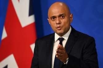 """Britain's Health Secretary Sajid Javid speaks during a press conference inside the Downing Street Briefing Room in central London on October 20, 2021. - Britain's Health Secretary Sajid Javid on Wednesday rejected calls to trigger """"Plan B"""" measures to mitigate spiralling Covid infection rates, even as he warned that cases could reach as many 100,000 a day over the winter months. (Photo by TOBY MELVILLE / POOL / AFP)"""