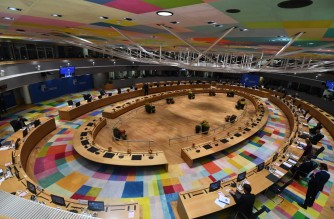 A picture taken on October, 21 2021 shows a general view of leaders attending a roundtable meeting during a European Union (EU) summit at The European Council Building in Brussels as EU leaders discuss Covid-19, digital transformation, energy prices, migration, trade and external relations. (Photo by JOHN THYS / POOL / AFP)