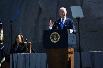 US President Joe Biden, with Vice President Kamala Harris, speaks at a ceremony marking the 10th Anniversary dedication of the Martin Luther King, Jr., Memorial, in Washington, DC, on October 21, 2021. (Photo by Brendan Smialowski / AFP)