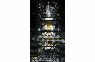 """This handout image courtesy of NASA released on October 22, 2021 shows Orion spacecraft placed atop the Space Launch System (SLS) Moon rocket, completing assembly for the Artemis I flight test at NASA's Kennedy Space Center in Florida. - NASA said October 22, 2021 it is now targeting February 2022 for the uncrewed lunar mission Artemis 1, the first step in America's plan to return humans to the Moon later this decade. (Photo by NASA / AFP) / RESTRICTED TO EDITORIAL USE - MANDATORY CREDIT """"AFP PHOTO / NASA """" - NO MARKETING - NO ADVERTISING CAMPAIGNS - DISTRIBUTED AS A SERVICE TO CLIENTS"""