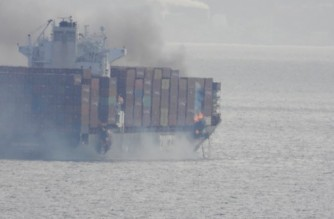 """In this photo taken by Gerald Graham and recieved by AFP on October 24, 2021, smoke is seen rising from the side of the container ship Zim Kingston off Canada's Pacific coast. - The Canadian coast guard has evacuated 16 people from a burning container ship that is expelling toxic gas off Canada's Pacific coast, but there is """"no safety risk"""" to those on shore, authorities said. The Zim Kingston ship had been bound for Vancouver when the flames erupted, with the fire reported to the coast guard at around 11 pm local time Saturday, CBC News reported. (Photo by Gerald Graham / Gerald Graham / AFP) / RESTRICTED TO EDITORIAL USE - MANDATORY CREDIT """"AFP PHOTO /Gerald Graham/ HO """" - NO MARKETING - NO ADVERTISING CAMPAIGNS - DISTRIBUTED AS A SERVICE TO CLIENTS"""