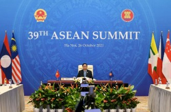 Vietnam's Prime Minister Pham Minh Chinh takes part in the 39th Association of Southeast Asian Nations (ASEAN) summit held online on a live video conference in Brunei due to the COVID-19 coronavirus pandemic, in Hanoi on October 26, 2021. (Photo by Nhac NGUYEN / AFP)