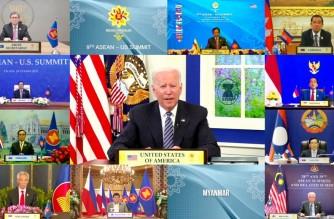 """This handout photo released by the host broadcast, ASEAN Summit 2021, on October 26, 2021 shows US President Joe Biden (C) taking part in the ASEAN-US Summit on the sidelines of the 2021 Association of Southeast Asian Nations (ASEAN) summits held online on a live video conference in Bandar Seri Begawan, Brunei. (Photo by Handout / ASEAN Summit 2021 / AFP) / -----EDITORS NOTE --- RESTRICTED TO EDITORIAL USE - MANDATORY CREDIT """"AFP PHOTO / ASEAN Summit 2021 """" - NO MARKETING - NO ADVERTISING CAMPAIGNS - DISTRIBUTED AS A SERVICE TO CLIENTS"""