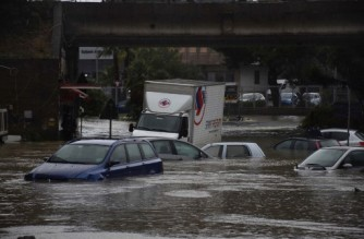 This photo taken on October 26, 2021 and obtained from Italian news agency Ansa on October 27, 2021 sows cars submerged in the 'Monte Po' district of Catania, Sicily, after heavy rain hit the city and the province. (Photo by STRINGER / ANSA / AFP) / Italy OUT