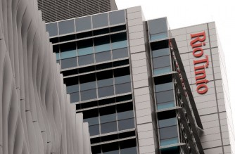 A Rio Tinto sign adorns their building in central Brisbane on December 5, 2011.  AFP PHOTO / WILLIAM WEST (Photo by WILLIAM WEST / AFP)