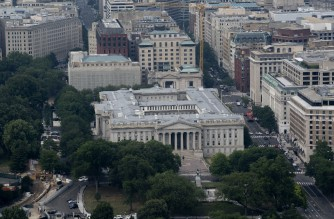 WASHINGTON, DC - JULY 25: The Treasury Department is seen from the Washington Monument on July 25, 2021 in Washington, DC. Lawmakers are working to finalize an infrastructure agreement before the August recess, but may face delays due to a number of disputes, including how much to increase public transit funding, as well as highways and bridges.   Stefani Reynolds/Getty Images/AFP (Photo by Stefani Reynolds / GETTY IMAGES NORTH AMERICA / Getty Images via AFP)