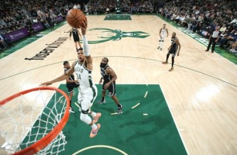 MILWAUKEE, WI - OCTOBER 19: Giannis Antetokounmpo #34 of the Milwaukee Bucks dunks the ball during the game against the Brooklyn Nets on October 19, 2021 at the Fiserv Forum Center in Milwaukee, Wisconsin. NOTE TO USER: User expressly acknowledges and agrees that, by downloading and or using this Photograph, user is consenting to the terms and conditions of the Getty Images License Agreement. Mandatory Copyright Notice: Copyright 2021 NBAE   Nathaniel S. Butler/NBAE via Getty Images/AFP. (Photo by Nathaniel S. Butler / NBAE / Getty Images / Getty Images via AFP)