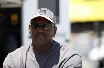SONOMA, CALIFORNIA - JUNE 06: NBA Hall of Famer Michael Jordan and co-owner of 23XI Racing waits in the #23 DoorDash Toyota pit area prior to the NASCAR Cup Series Toyota/Save Mart 350 at Sonoma Raceway on June 06, 2021 in Sonoma, California.   Maddie Meyer/Getty Images/AFP (Photo by Maddie Meyer / GETTY IMAGES NORTH AMERICA / Getty Images via AFP)