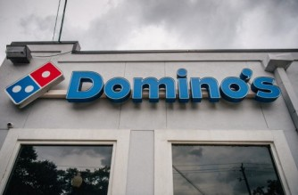 HOUSTON, TEXAS - JULY 22: A Domino's Pizza sign is shown on July 22, 2021 in Houston, Texas. Domino's pizza has reported that its U.S. same-store sales have increased by 3.5% in its latest quarter of production. CEO Ritch Allison has said that the company will raise wages for employees, in certain markets and positions, at corporate-owned restaurants. Allison also noted that a lack of staffing and equipment shortages have been major hurdles as the company continues to deal with problems tied to the pandemic.   Brandon Bell/Getty Images/AFP (Photo by Brandon Bell / GETTY IMAGES NORTH AMERICA / Getty Images via AFP)