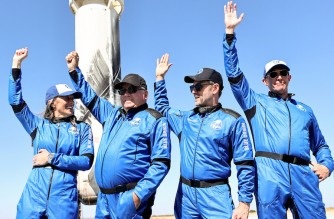 VAN HORN, TEXAS - OCTOBER 13: (L-R) Blue Origins vice president of mission and flight operations Audrey Powers, Star Trek actor William Shatner, Planet Labs co-founder Chris Boshuizen and Medidata Solutions co-founder Glen de Vries wave during a media availability on the landing pad of Blue Originís New Shepard after they flew into space on October 13, 2021 near Van Horn, Texas. Shatner became the oldest person to fly into space on the ten minute flight. They flew aboard mission NS-18, the second human spaceflight for the company which is owned by Amazon founder Jeff Bezos.   Mario Tama/Getty Images/AFP (Photo by MARIO TAMA / GETTY IMAGES NORTH AMERICA / Getty Images via AFP)