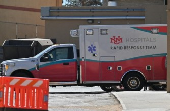 """ALBUQUERQUE, NEW MEXICO - OCTOBER 22: An exterior view shows an ambulance parked at the University of New Mexico Hospital, where """"Rust"""" Director of Photography Halyna Hutchins was transported and later pronounced dead after being injured during filming, on October 22, 2021 in Albuquerque, New Mexico. Hutchins was killed and director Joel Souza was injured on set while filming the movie """"Rust"""" at Bonanza Creek Ranch near Santa Fe, New Mexico on October 21, 2021. The film's star and producer Alec Baldwin discharged a prop firearm that hit Hutchins and Souza.   Sam Wasson/Getty Images/AFP (Photo by Sam Wasson / GETTY IMAGES NORTH AMERICA / Getty Images via AFP)"""