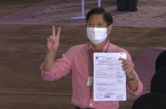 """Former Senator Ferdinand """"Bongbong"""" Marcos Jr., files his certificate of candidacy with the Commision on Elections on Wednesday, Oct. 6, 2021 (Screenshot of Agence France Presse video)"""